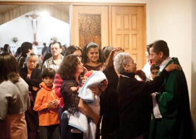 The local congregation of San Antonio de Escazú leaves a special mass to be blessed by the parish priest.