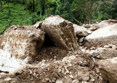 Displaced rocks that previously formed a natural dam had come down the mountainside of Pico Blanco due to the heavy rainfall.