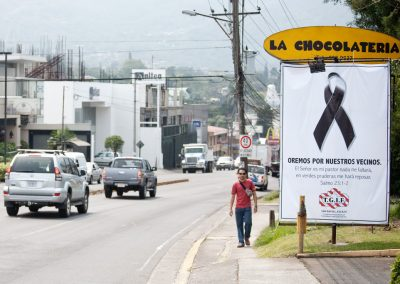 """TGIF roadside advertisement honoring  those who died in the mudslides reads :  """"Let us pray for our neighbors"""" and continues citing Psalm 23: 1-2: """"The Lord is my Shepherd, I lack nothing. He makes me lie down in green pastures""""."""