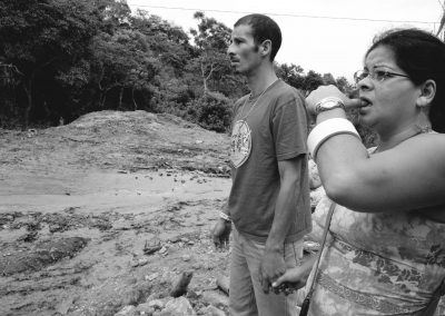 Luis Marin and Alexandra Amador lost everything. They look in disbelief at the ravages of their town of San Antonio de Escazú.