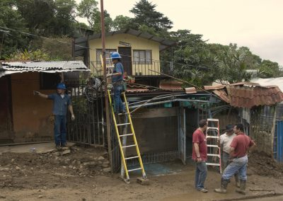Workers restoring electricity to the lucky houses that escaped direct damage. Power outage were reported throughout the country.