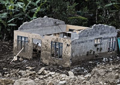 An abandoned house stands in the middle of the mud and rocks.   During the five day rescue mission,fifty people worked relentlessly to provide food, shelter and comfort to inhabitants like the owners of this house who lost all their belongings.