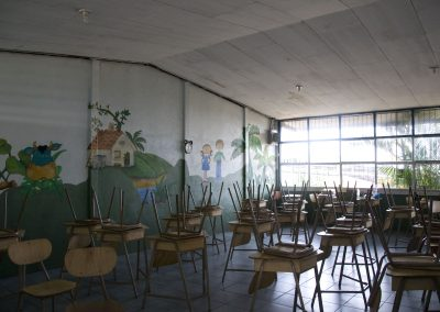 The school of El Carmen closed for ten days.  Various local and national authorities used it as a control and staging center.  Three school children perished along with various family members of other students.